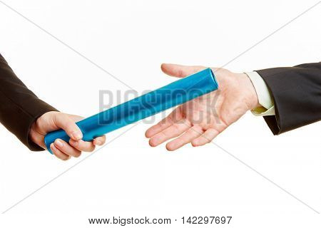 Handover of the baton in a relay race between two business people