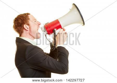 Businessman holding a megaphone and screaming and motivating people