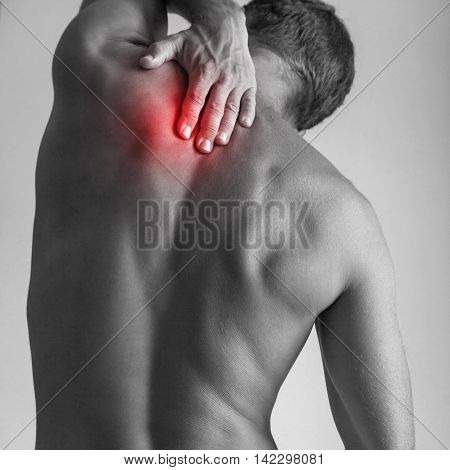 Young Man With Red Spot Of Backache