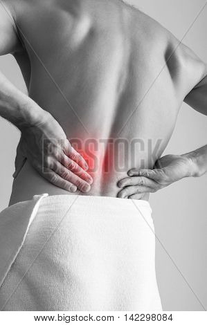 Young Adult Man With Backache. Black