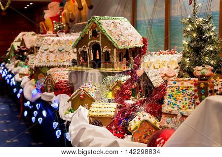 A colorful Christmas scene with gingerbread houses