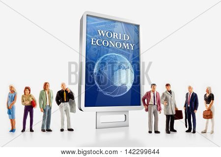Miniature people- people in front a billboard with Blue globe  about world economy