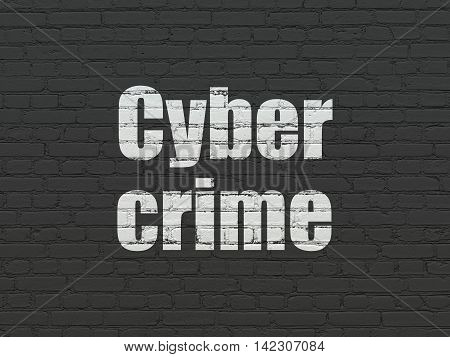 Security concept: Painted white text Cyber Crime on Black Brick wall background