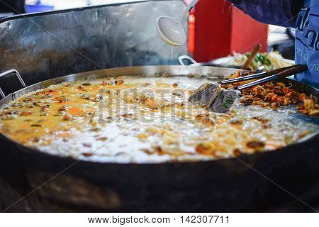 cooking Mussel fried in egg batter Mussel omelette on a big pan at thai market style