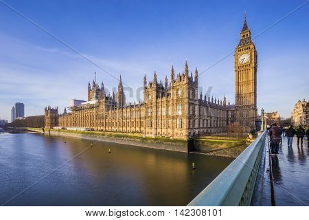 Houses of Parliament and Big Ben with River Thames on an early morning shot in central London, UK