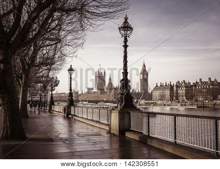 Early in the morning in central London with footpath, Big Ben and Houses of Parliament - vintage version - London, UK