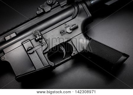 M4A1 assault rifle on black background,