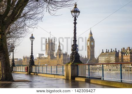 Footpath with Big Ben and Houses of Parliament at early in the morning - Central London, UK