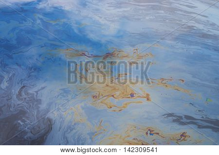 oil slick spreads on the water surface