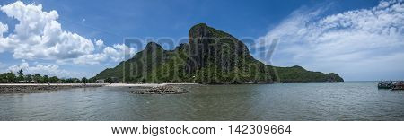 panorama view of the sea and rock beach with long big mountain and beautiful blue sky cloud in background Prachuapkhirikhan Thailand