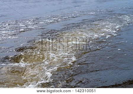 seething water on the track of the boat