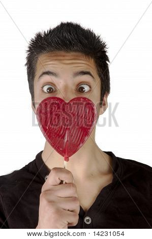 Pakistani Teenage Boy Is Looking Surprised At A Lolly Heart