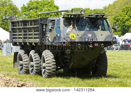 DENMEAD, UK - MAY 25: An ex British Army Alvis Stalwart amphibious vehicle gives a driving display to the watching public at the Overlord military show on May 25, 2013 in Denmead