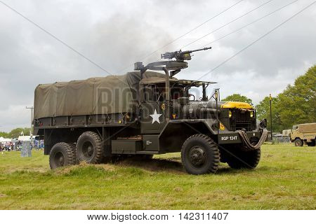 DENMEAD, UK - MAY 24: An ex US army GS Whistler supply & service truck climbs out of a tank ditch in the main arena at the Overlord show on May 24, 2015 in Denmead.