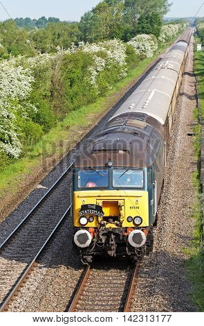 PIDDINGTON, UK - MAY 17: A charter train passes down the Chiltern line on May 17, 2014 in Piddington. Chiltern rail is the only rail operating company to achieve a 95% Public Performance Measure (PPM)