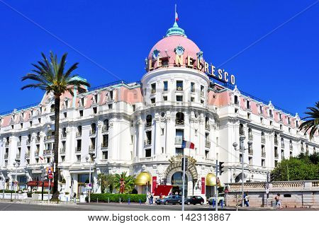 NICE, FRANCE - MAY 16: The famous Le Negresco Hotel on May 16, 2015 in Nice, France. This historic luxury hotel, located in the Promenade des Anglais, is a landmark in the city