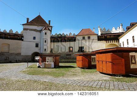 KEZMAROK SLOVAKIA - JULY 08 2016: The big yard and towers of old castle in Kezmarok town High Tatras Slovakia.