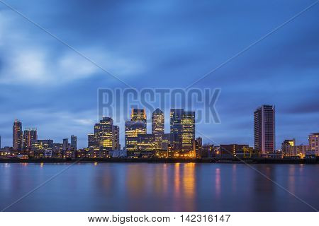 The famous business district and skyscrapers of Canary Wharf at blue hour - London, UK