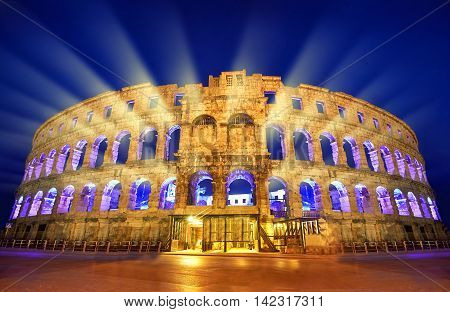 The Roman Amphitheater of pula Croatia at night.