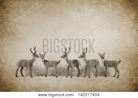 Group of five reindeer or elk on old wooden shabby vintage background for christmas decoration or a card.