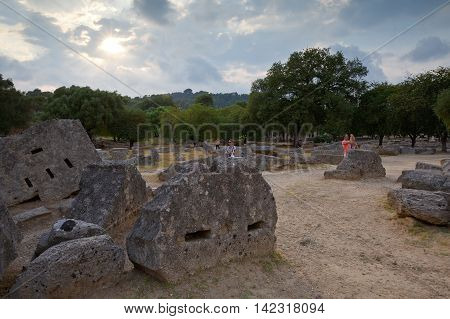 OLYMPIA, GREECE - AUGUST 08, 2016: Remains of Temple of Zeus in the archaeological site of Ancient Olympia on August 08, 2016.