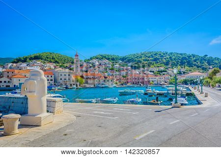 View at promenade and cityscape in Pucisca, Island of Brac, Croatia.