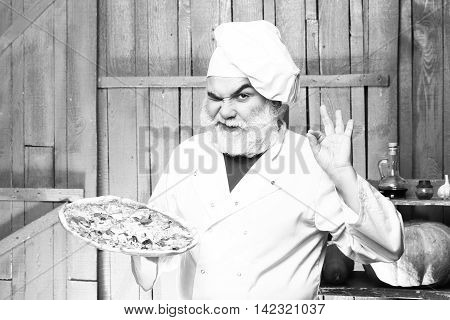 Bearded Cook With Pizza