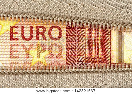 Business money concept with ten Euro and zipper