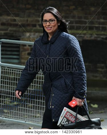 LONDON, UK, JUN 14, 2016: Priti Patel carrying a Sun Newspaper in her bag arriving in Downing Street for the weekly cabinet meeting