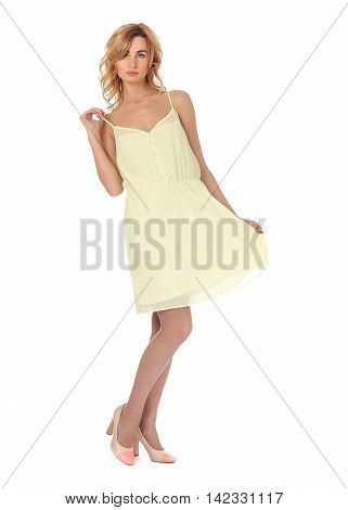 Fashion model wearing lime sundress isolated on white