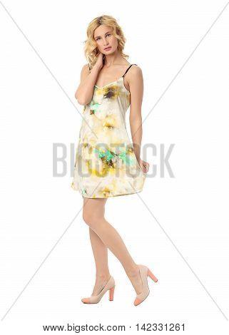 Fashion model wearing flowered sundress isolated on white