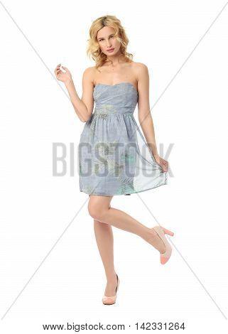 Fashion model wearing blue sundress isolated on white