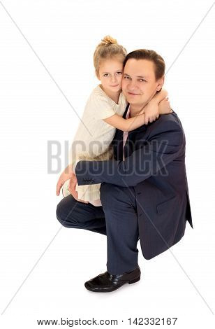 Happy little girl hugging his neck beloved father - Isolated on white background