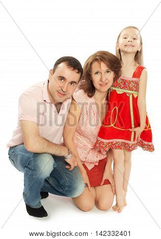 Happy family of three. Dad, mom and little charming daughter.Daughter stood on tiptoe-Isolated on white background