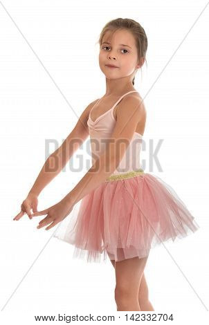 Beautiful barefoot girl gymnast in pink dress . The girl crossed her arms in front of him . close-up-Isolated on white background