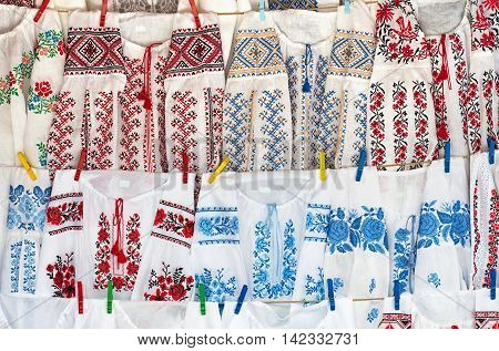 great Sorochintsy Ukraine - August 19 2015: embroidered women's dresses on clothespins at the fair