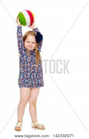 Funny little girl with long blond hair below the shoulders, which are attached to a large blue flower . In a short blue dress, holds ball over head - Isolated on white background