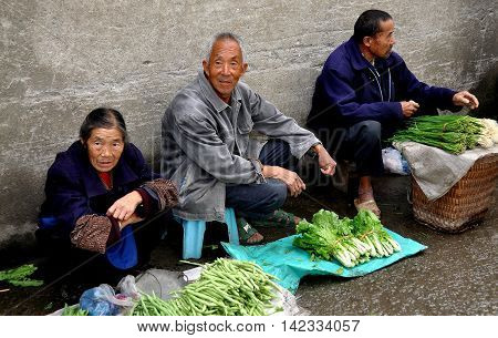 Ao Ping China - September25 2012: Local farmers sitting on the street sell their produce at the Ao Ping outdoor market