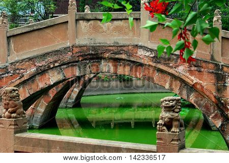 Deyang China - July 8 2007: Three graceful bridges span the Pan Pond at the 13th century Deyang Confucian Temple *