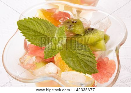 Fresh fruit salad on a white background. Dessert.