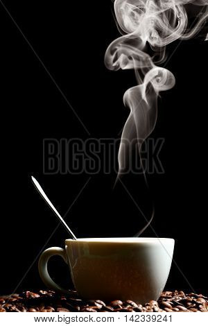 Cup of hot fragrant coffee and coffee beans. Coffee house. Uplifting mood. Coffee break. Relax. Increasing productivity in the mornings. Coffee breakfast.