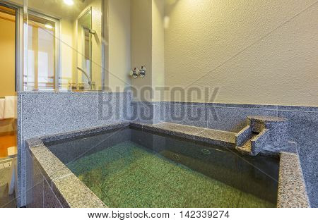 Private onsen bathtub in Japanese style bath