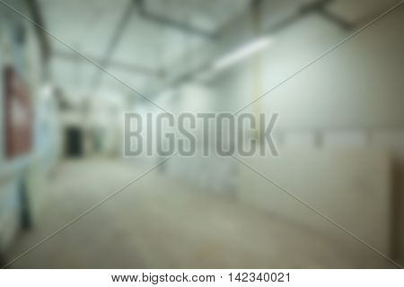 Empty warehouse office or commercial area theme creative abstract blur background with bokeh effect