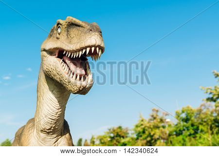 NOVI SAD SERBIA - AUGUST 7 2016: Velociraptor life size model of prehistoric animal in theme entertainment Dino Park. Raptor lived approximately 75 to 71 million years ago.