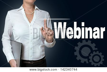 webinar touchscreen is operated by businesswoman background.