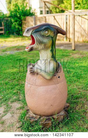NOVI SAD SERBIA - AUGUST 7 2016: Small dinosaur trash bin toy from themed entertainment Dino Park in Novi Sad.