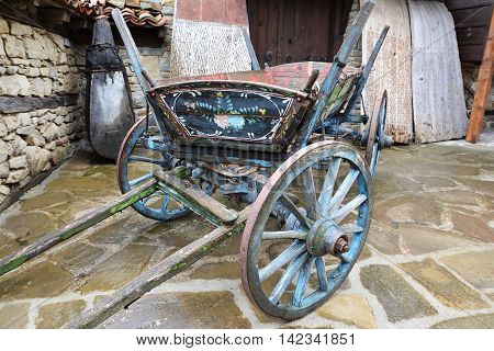Vintage painted wooden cart in village of Zheravna Bulgaria