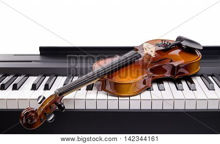 Violin on the keys digital piano closeup