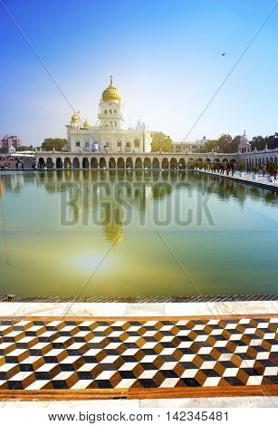 The temple of Sikh religion (1783 year) on the bank of a sacred reservoir India Delhi