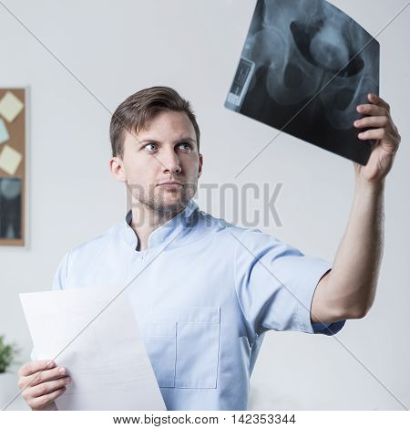 Doctor Looking At X-ray Photo